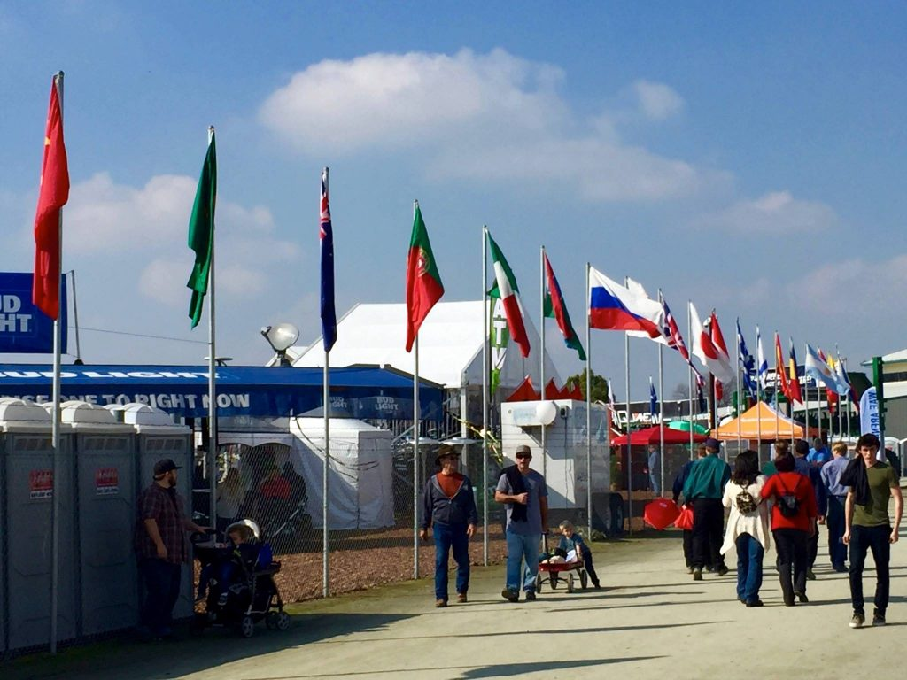 The flags of all the countries represented at the World Ag Expo line the entrance.